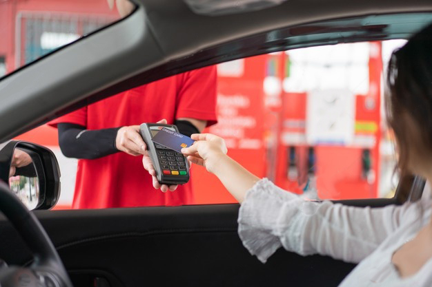 Woman Using Fuel Card